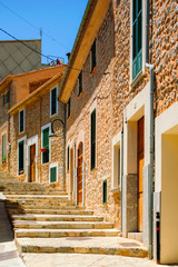 Colorful street in mediterranean village with cobblestone