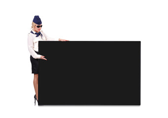 Flight attendant holding blackboard