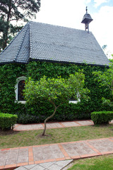 small chapel with green trees