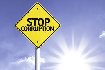 Stop Corruption road sign with sun background