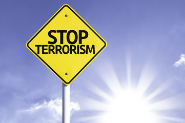 Stop Terrorism road sign with sun background