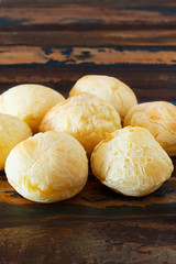 Brazilian snack cheese bread (pao de queijo) in wooden table