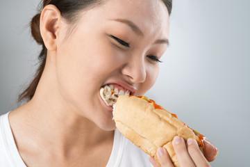 Biting hot dog