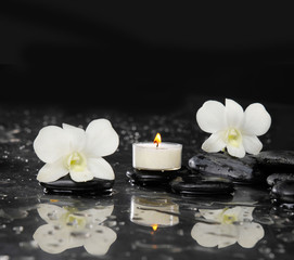 Two white orchid with white candle and therapy stones reflection
