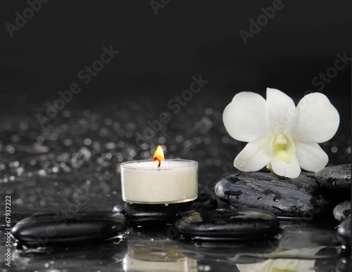 Poster Spa Spa still life with white orchid and candle on pebbles