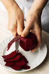 Woman chef prepare beets in the kitchen.