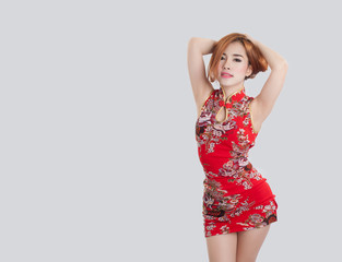 Asian model wearing Cheongsam with copy space for product or tex