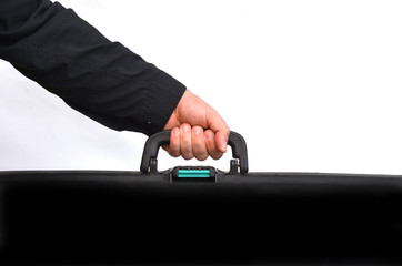Hand of a man carry travel suitcase