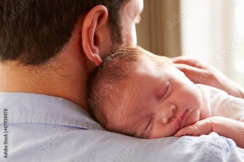 Leinwanddruck Bild Father At Home With Sleeping Newborn Baby Daughter