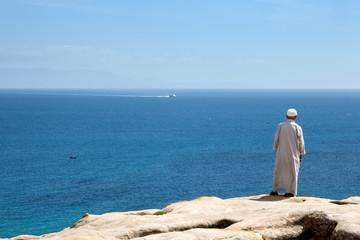 Muslim man back at the seaside