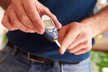 Male Diabetic Checking Blood Sugar Levels