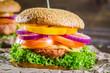 Obrazy drukowane na płótnie, fototapety, zdjęcia, fotoobrazy cyfrowe : Tasty homemade two hamburgers