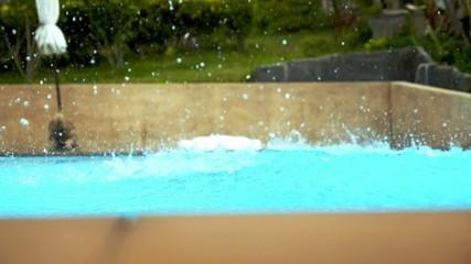 Swimming Pool Splash. Man Diving. Slow Motion.