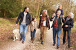 Multi Generation Family On Countryside Walk - 67940264
