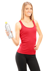 Vertical shot of a young woman holding a water bottle