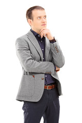 Pensive young man posing