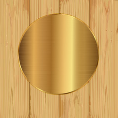 Gold round on a planks
