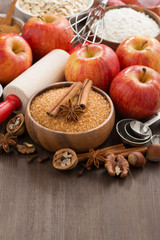 ingredients for baking apple pie and wooden background