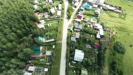 Flying over the village. Aerial Shot.