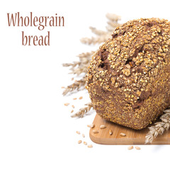 whole grain bread with seeds on a wooden board, isolated