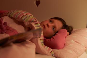 Worried Girl Lying In Bed Awake At Night