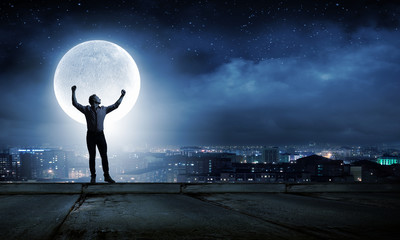 Man and full moon