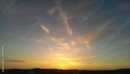 canvas print picture Wolkendunst im Sonnenuntergang