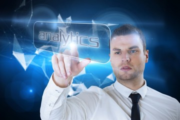 Businessman pointing to word analytics