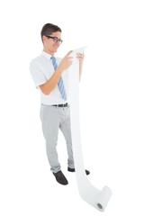 Geeky happy businessman reading a long receipt