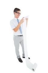 Geeky happy businessman reading a long receipt