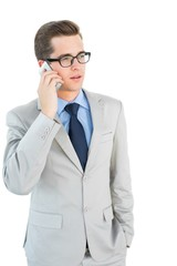 Geeky businessman talking on cellphone