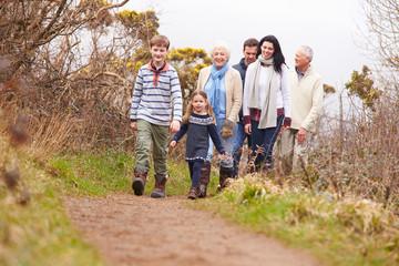 Multi Generation Family On Countryside Walk