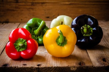 Red, green, black, white and yellow bell peppers