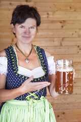 Woman in dirndl with beer mug