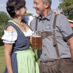 Man and woman with beer mug in Bavaria