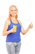 Mature lady holding a juice and giving thumb up