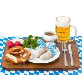 Weißwürste mit Bier und Brezel