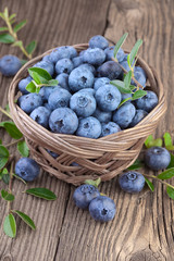 Blueberries over wooden background