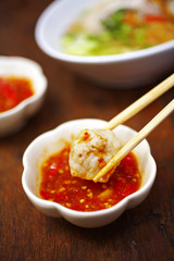 close up fishball and spicy dip in white cup