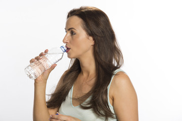 portrait of a woman holding a bottle of drinking water