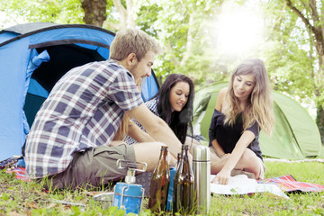 teenagers camping look at a map