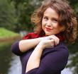 woman  near the river in autumn season