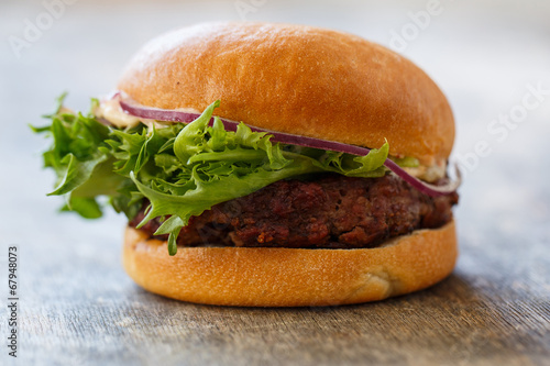 canvas print picture Delicious burger on the table
