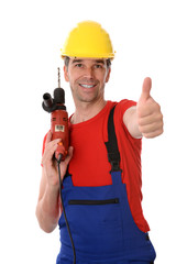 worker with drilling machine and thumb up