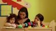 6of15 Child, girls, teacher playing in kindergarten, school