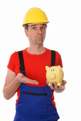 worker with helmet is pointing of a piggy bank