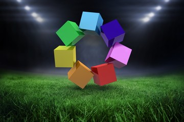 Composite image of 3d colourful cubes in a circle