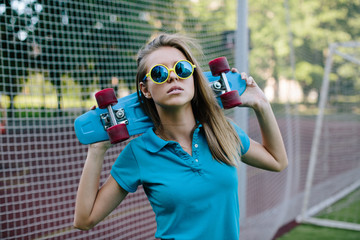 Girl posing with skateboard