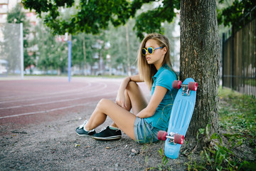 beautiful girl sitting in the park