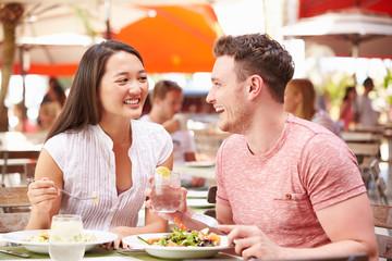 Couple Enjoying Lunch In Outdoor Restaurant